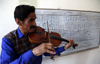 Yemeni music teacher persists in teaching young students for free