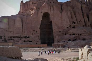 Tourists visit ruined Buddha statue in Bamyan province, Afghanistan