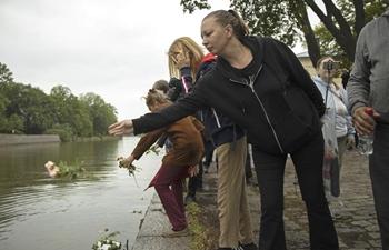 People commemorate victims of terrorist attack in Turku, Finland