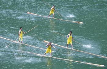 Villagers perform single bamboo drifting in China's Fujian
