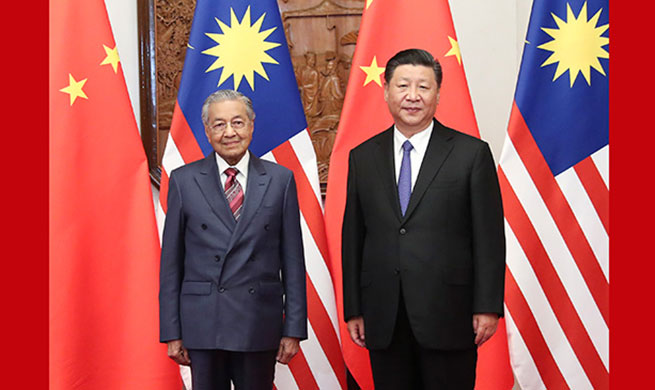 Xi meets Malaysian PM, calling for better ties in new era