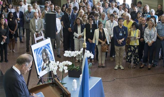 People pay tribute to Kofi Annan at Palais des Nations in Geneva