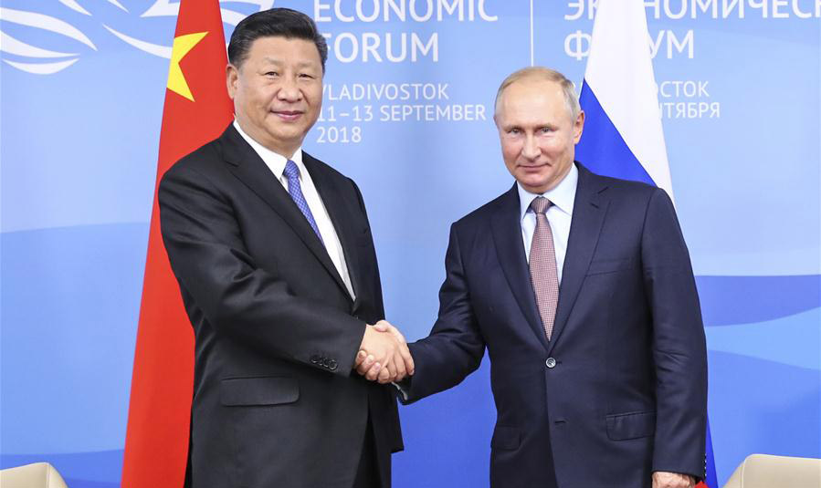 Xi, Putin vow to promote ties regardless of global changes