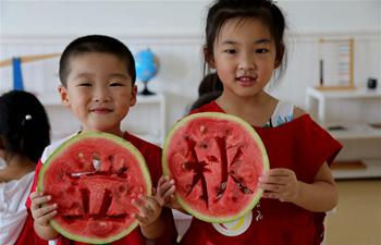 Children eat watermelons to celebrate coming of autumn across China