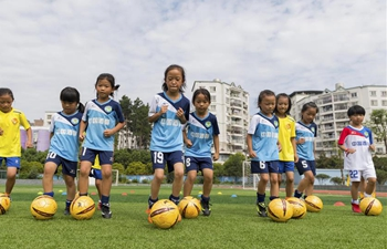 Girl students practice football in SW China's Guizhou