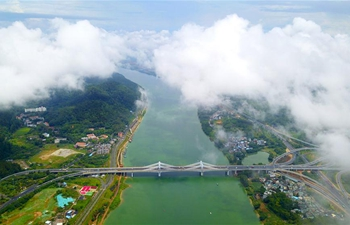 In pics: scenery after raining of Liuzhou City in south China