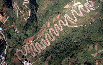 Scenery of winding road in SW China's Yunnan