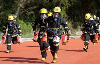 Fire fighters participate in drill in Xiamen, southeast China's Fujian