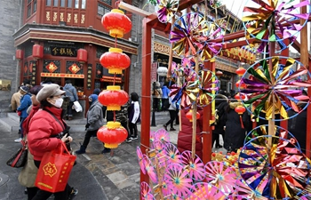 Tourists visit Qianmen street in Beijing during Spring Festival holiday