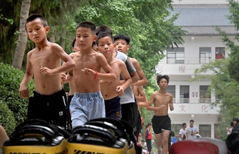 Pic story: Young learners practise Taiji in central China's Henan Province
