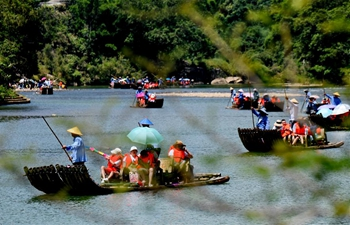 Tourists enjoy themselves in Wuyishan scenic spot in China's Fujian