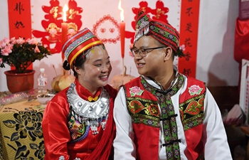 In pics: delayed wedding ceremony for couple devoted in poverty alleviation