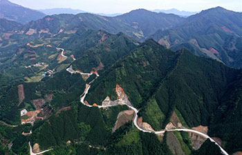Locals to benefit from road building as part of poverty alleviation efforts in China's Guangxi