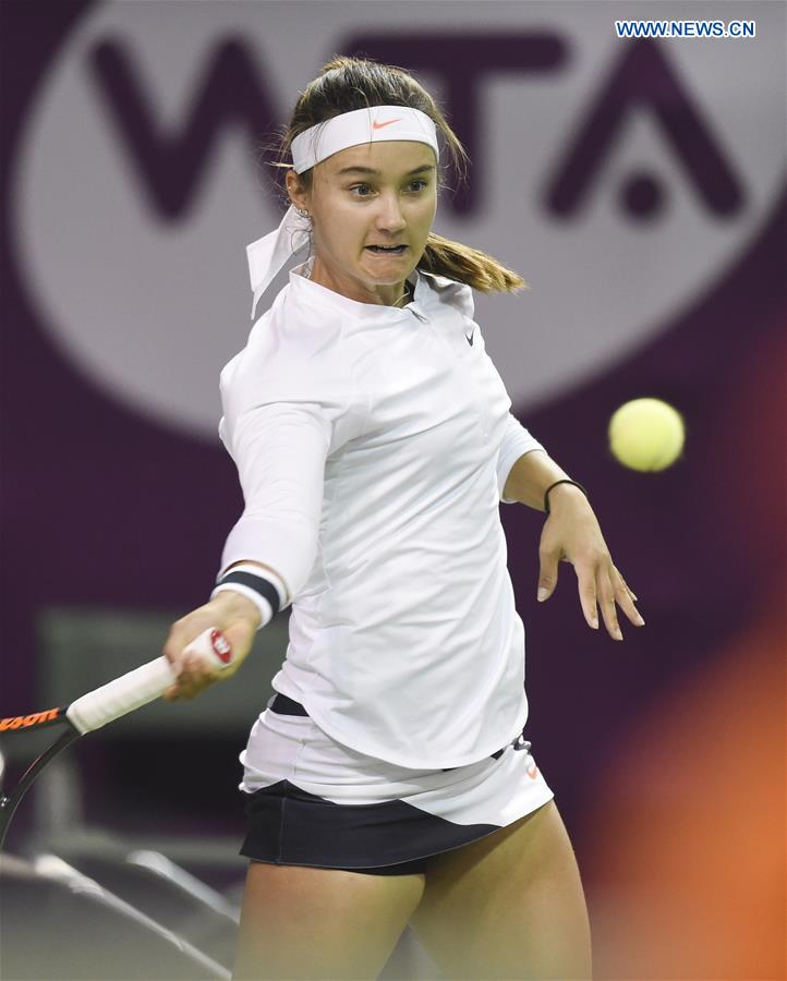 Lauren Davis of United States returns the ball during the women's singles 2nd round qualifying match against Wang Qiang of China at WTA Qatar Open 2017 at the International Khalifa Tennis Complex of Doha, Qatar, Feb. 12, 2017.