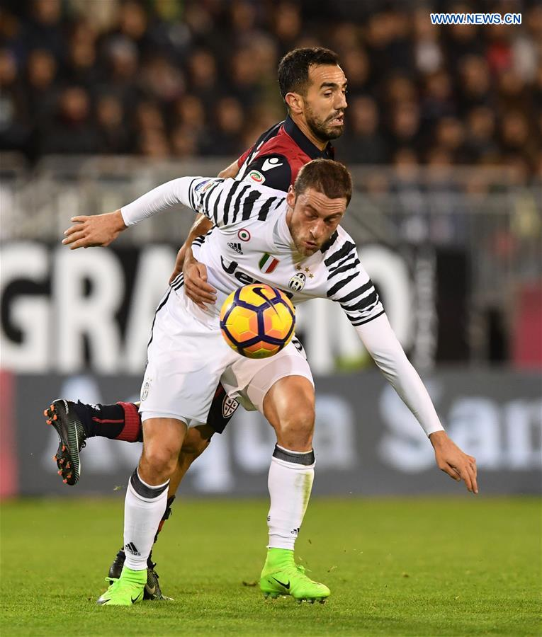 Juventus' Claudio Marchisio(Front) vies with Cagliari's Marco Sau during the Serie A soccer match between Juventus and Cagliari, in Cagliari, Italy, Feb. 12, 2017.