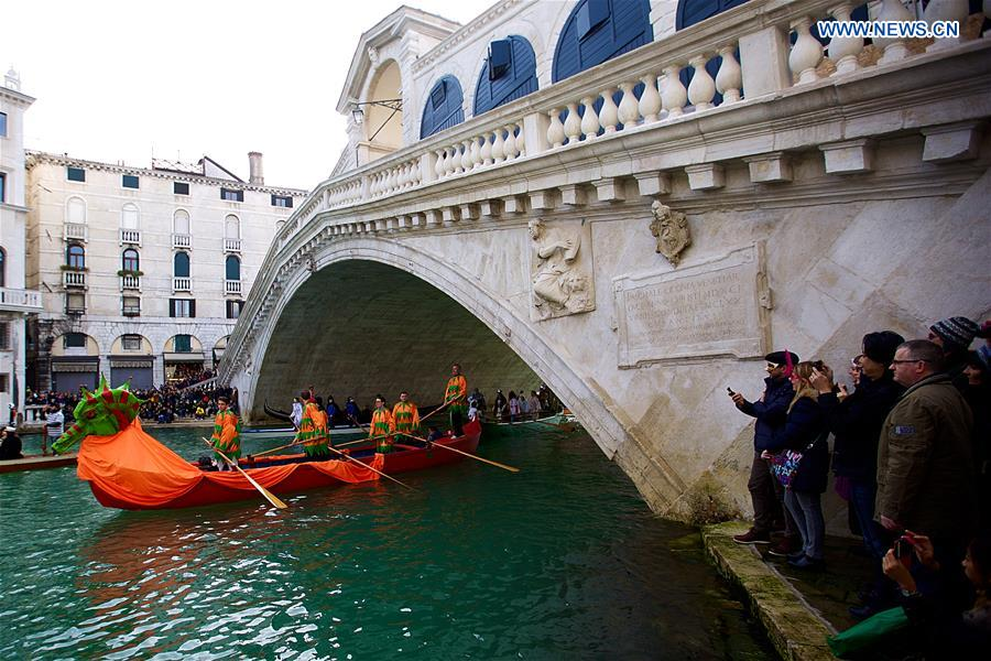 ers wearing costumes sail during the Water Parade event of the Venice Carnival in Venice, Italy, Feb. 12, 2017.