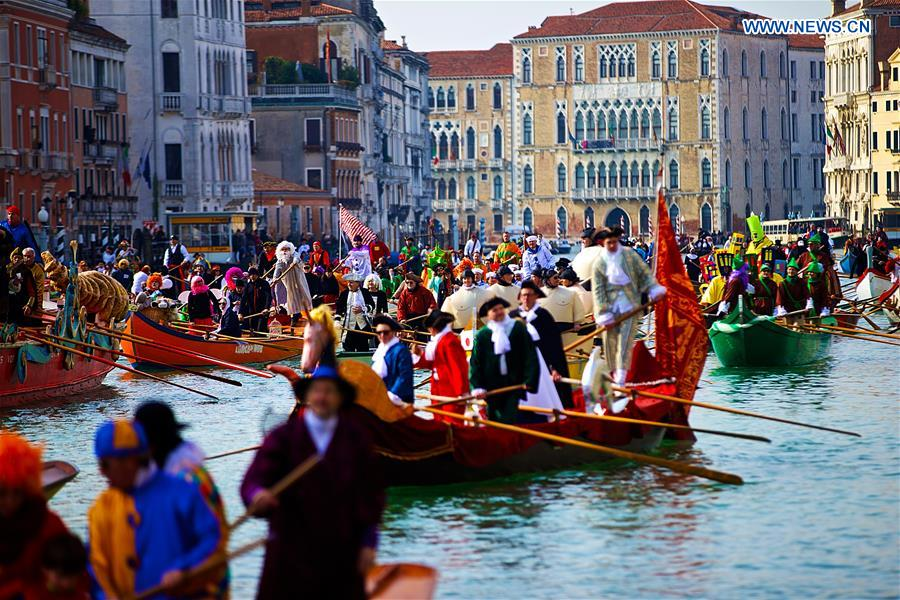 Rowers wearing costumes sail during the Water Parade event of the Venice Carnival in Venice, Italy, Feb. 12, 2017.