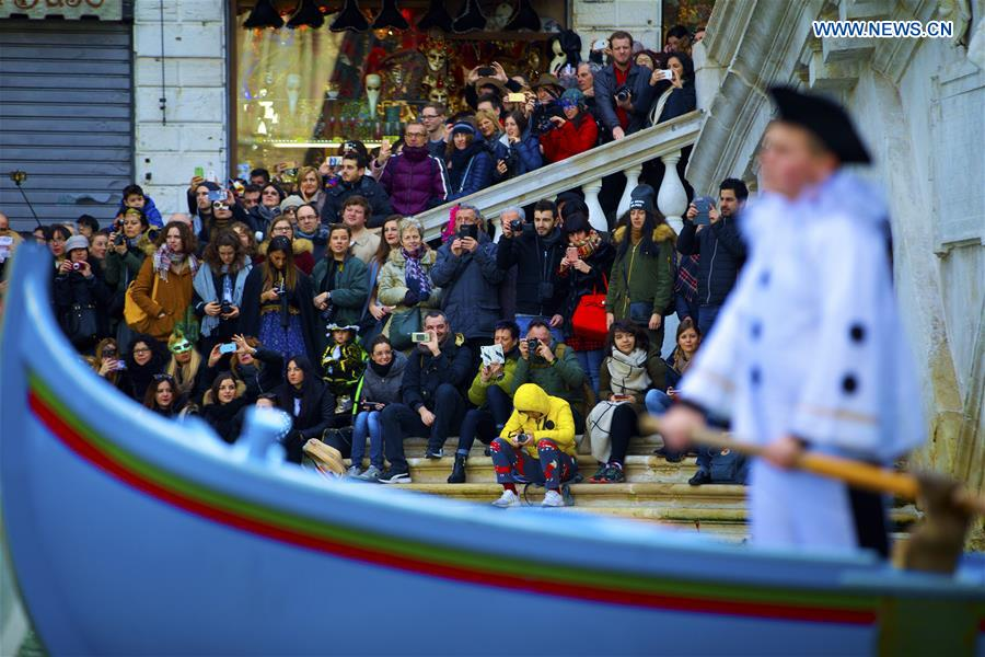 People watch the Water Parade event of the Venice Carnival in Venice, Italy, Feb. 12, 2017.