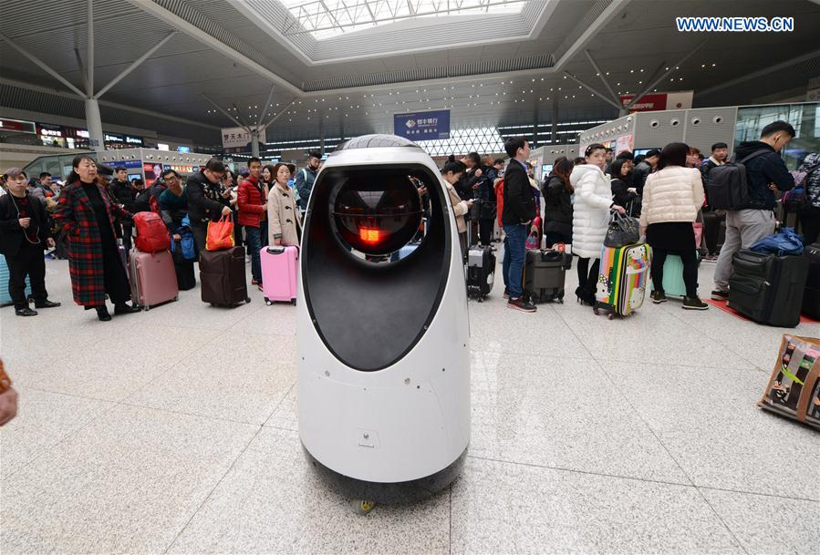 A robot patrols at the Zhengzhou East Railway Station in Zhengzhou, capital of central China's Henan Province, Feb. 15, 2017.