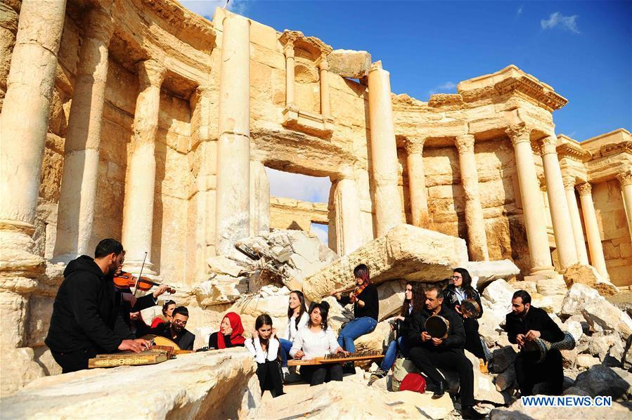 A musical band plays amid the rubble of the ruined Roman Theater in the ancient city of Palmyra, central Syria, on March 4, 2017. The Syrian army announced in a statement that the Syrian forces captured the ancient city of Palmyra in central Syria on Thursday after battles with the Islamic State (IS) group.