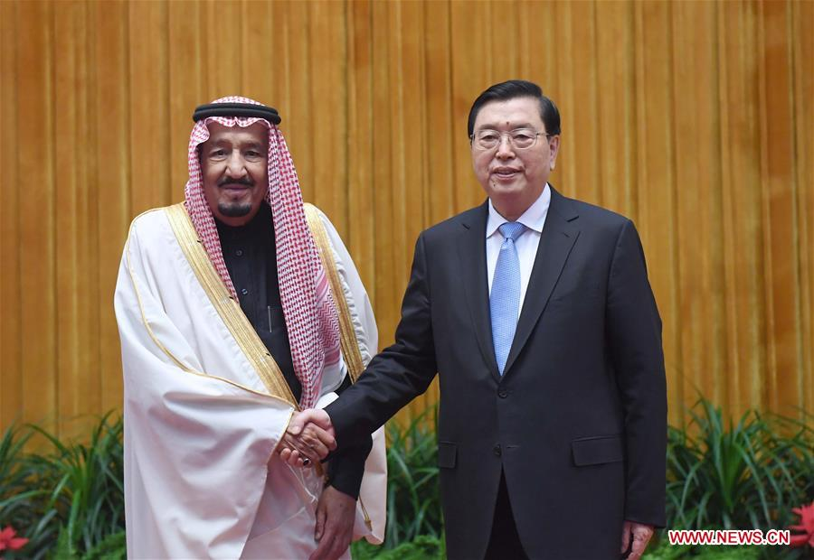 Zhang Dejiang (R), chairman of the Standing Committee of China's National People's Congress, meets with Saudi King Salman bin Abdulaziz Al Saud at the Great Hall of the People in Beijing, capital of China, March 17, 2017. (Xinhua/Zhang Duo)