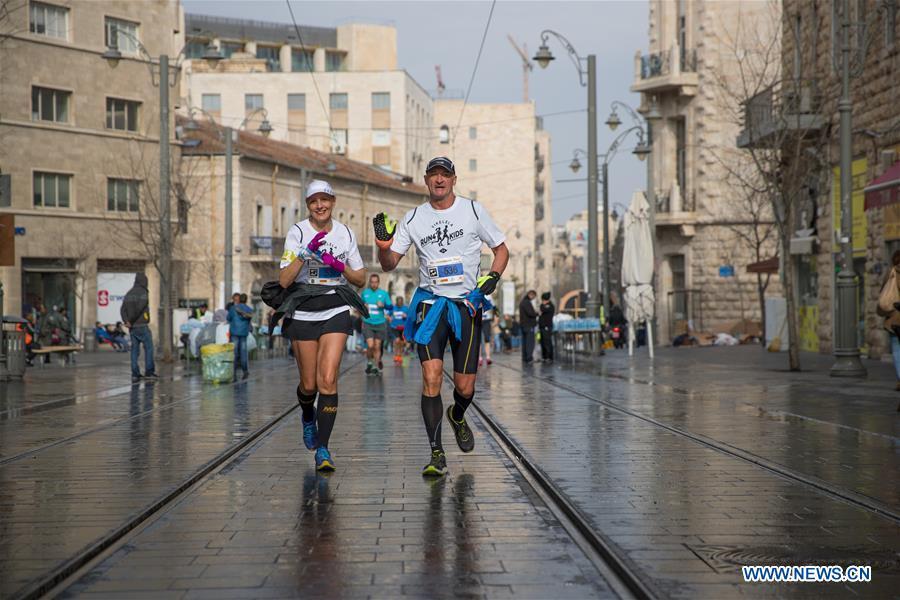 Runners take part in the 7th International Jerusalem Winner Marathon in Jerusalem, on March 17, 2017. (Xinhua/Guo Yu)