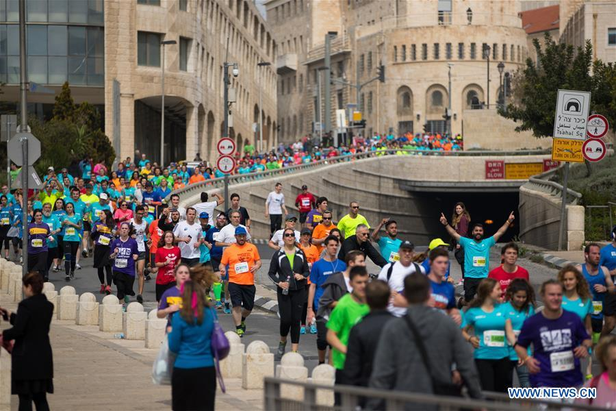 Runners take part in the 7th International Jerusalem Winner Marathon in Jerusalem, on March 17, 2017. (Xinhua/Guo Yu)
