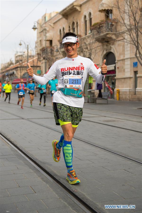 A Chinese runner takes part in the 7th International Jerusalem Winner Marathon in Jerusalem, on March 17, 2017. (Xinhua/Guo Yu)