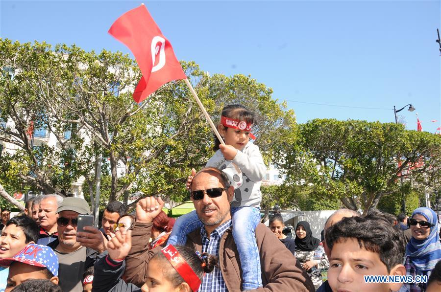 People celebrate the 61st anniversary of Independence Day in Tunis, Tunisia, March 20, 2017. (Xinhua/Adel Ezzine)