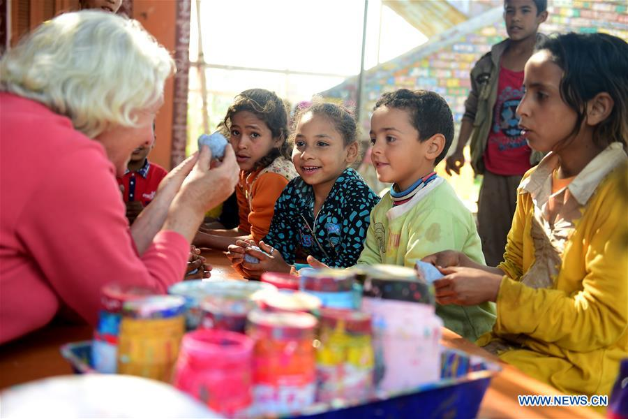 Lady Didi (L) teaches children how to shape clay at her Nile River School in Ayyat district on the outskirts of Giza Province, about 100 km south of Cairo, capital of Egypt, on March 26, 2017. Diana Sandor, known as Didi, an old Hungarian-born German-raised woman, covered the long distance from West to East six years ago to open her Nile River School as a charitable kindergarten and educational center at the heart of remote, impoverished Baharwa village of Ayyat district on the outskirts of Giza Province, about 100 km south of the Egyptian capital Cairo. Didi said she started building the center 'brick by brick,' through little donations from friends and volunteers around the world and that she is concerned with 'teaching children life,' not just languages and skills. (Xinhua/Zhao Dingzhe)