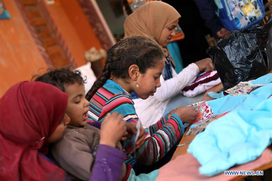 Children have a knitting class at lady Didi's Nile River School in Ayyat district on the outskirts of Giza Province, about 100 km south of Cairo, capital of Egypt, on March 26, 2017. Diana Sandor, known as Didi, an old Hungarian-born German-raised woman, covered the long distance from West to East six years ago to open her Nile River School as a charitable kindergarten and educational center at the heart of remote, impoverished Baharwa village of Ayyat district on the outskirts of Giza Province, about 100 km south of the Egyptian capital Cairo. Didi said she started building the center 'brick by brick,' through little donations from friends and volunteers around the world and that she is concerned with 'teaching children life,' not just languages and skills. (Xinhua/Ahmed Gomaa)