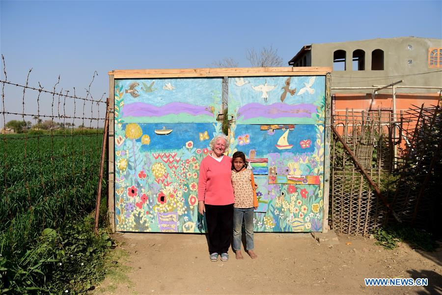 Lady Didi (L) poses for photo with an Egyptian girl at the gate of her Nile River School in Ayyat district on the outskirts of Giza Province, about 100 km south of Cairo, capital of Egypt, on March 26, 2017. Diana Sandor, known as Didi, an old Hungarian-born German-raised woman, covered the long distance from West to East six years ago to open her Nile River School as a charitable kindergarten and educational center at the heart of remote, impoverished Baharwa village of Ayyat district on the outskirts of Giza Province, about 100 km south of the Egyptian capital Cairo. Didi said she started building the center 'brick by brick,' through little donations from friends and volunteers around the world and that she is concerned with 'teaching children life,' not just languages and skills. (Xinhua/Zhao Dingzhe)