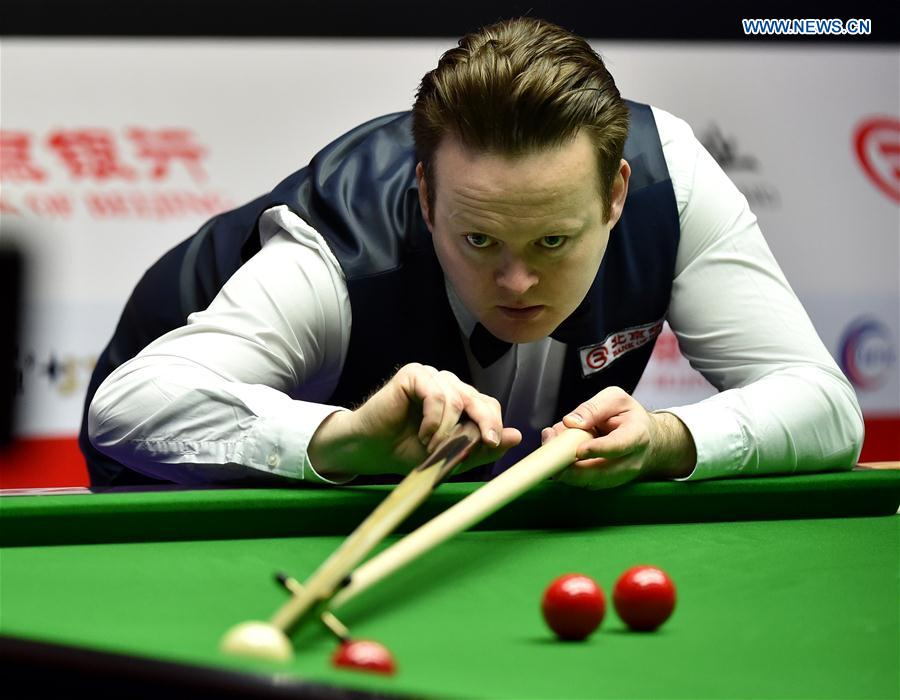 Shaun Murphy of England competes during the first round of 2017 World Snooker China Open Tournament against his compatriot Allen Taylor, in Beijing, capital of China, March 27, 2017.