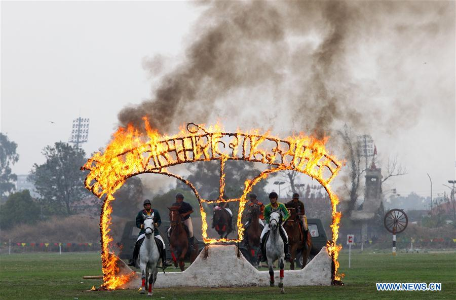 Horses jump through fire rings during the Ghode Jatra, a horse racing festival at Army Pavilion, Tundikhel in Kathmandu, Nepal, March 27, 2017. (Xinhua/Sunil Sharma)