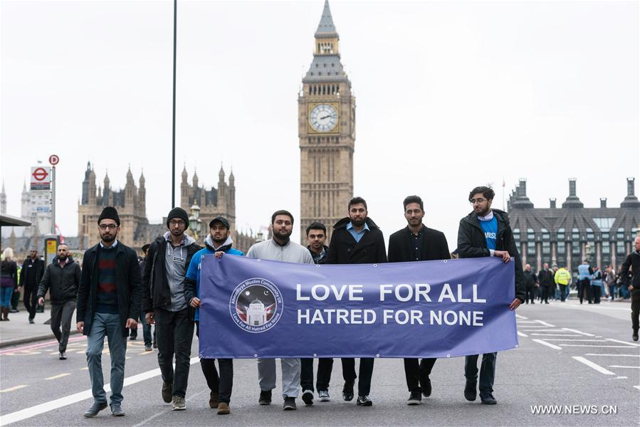 Members of muslim community attend an event on Westminster Bridge to commemorate the victims of last week's terror attacks in London, Britain on March 29, 2017.