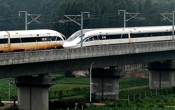 Chinese bullet trains cross in world first