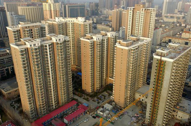 Economic Watch: China reins in galloping property market