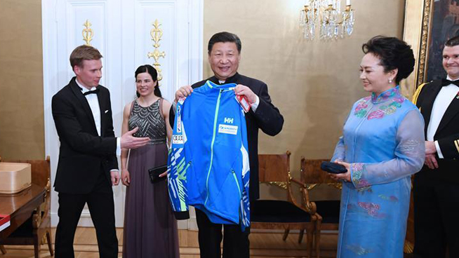 President Xi meets winter sports athletes from China and Finland