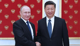 Xi, Putin agree to boost coordination on major issues