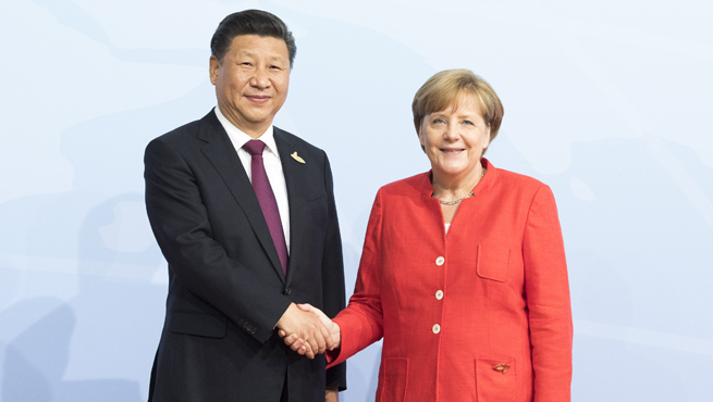 President Xi Jinping shakes hands with Chancellor Angela Merkel in Hamburg, Germany