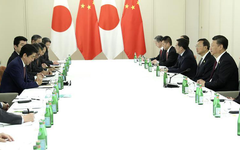 Xi, Abe meet on ties, reaffirm readiness to strengthen China-Japan partnership
