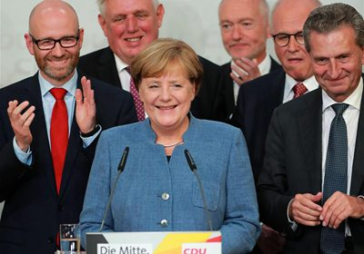 Merkel's party wins commanding yet lower votes as far-right AfD to debut in parliament