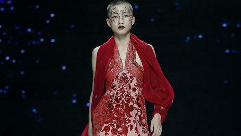 Models present creations of Alvin Fernandez in Beijing