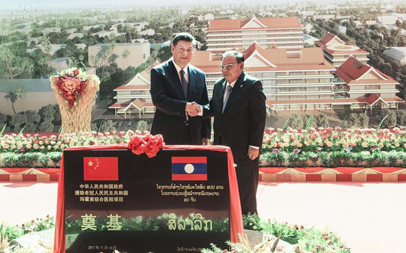 Xi calls for more China-Laos cooperation in public welfare