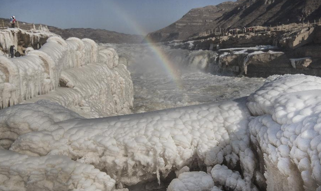 Rainbow, icicles seen on Hukou Waterfall scenic spot