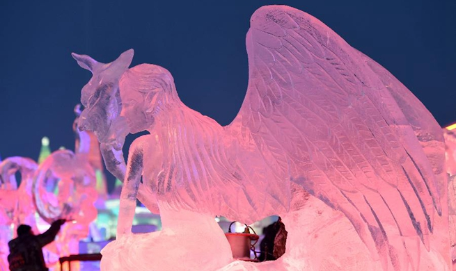 In pics: 2nd day of 32nd Harbin int'l ice sculpture competition in NE China