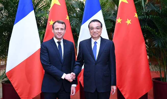 Chinese premier meets visiting French president in Beijing