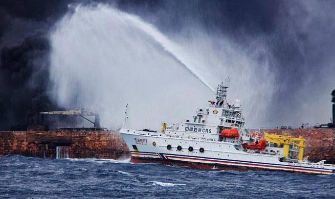 Chinese firefighters struggle to put out fire at stricken oil tanker