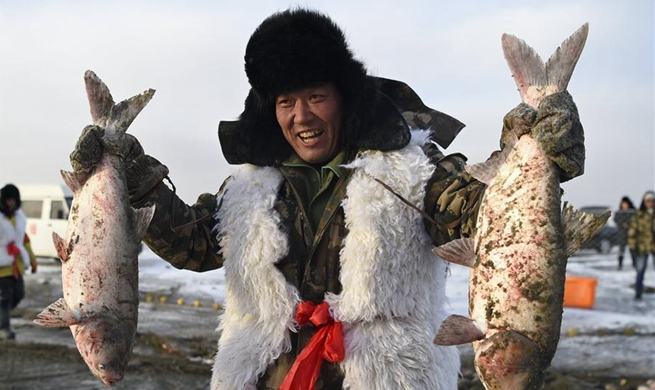 In pics: winter fishing at Wolong Lake in China's Liaoning