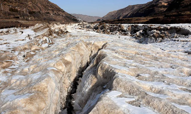 In pics: frozen Yellow River in north China's Shanxi